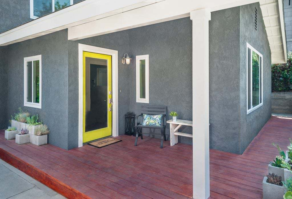 Designer renovated home with yellow front entry door